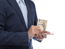 Businessman hand holding Japanese banknote. Businessman hands holding Japanese banknote Royalty Free Stock Photos