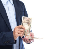 Businessman hand holding Japanese banknote. On white background Royalty Free Stock Photos