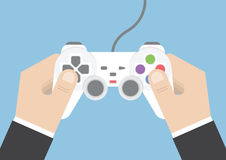 Businessman hand holding joystick or game controller Stock Photos