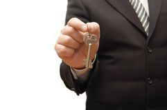 Businessman hand, holding key Royalty Free Stock Photo