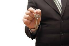 Businessman hand, holding key Royalty Free Stock Photo