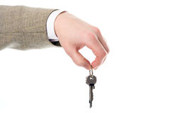 Businessman hand holding key to success Stock Image