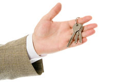 Businessman hand holding key to success Royalty Free Stock Photo