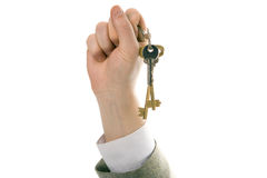 Businessman hand holding key to success Royalty Free Stock Photography