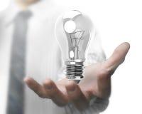 Businessman hand holding light bulb Royalty Free Stock Image