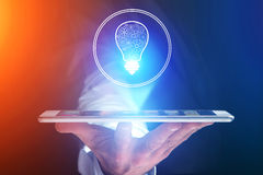 Businessman hand holding mobile phone with bulb idea icon. View of a Businessman hand holding mobile phone with bulb idea icon Stock Photos