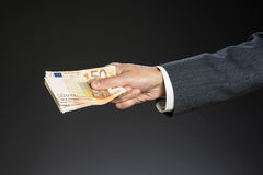 Businessman hand holding money. Fifty euros Stock Photos