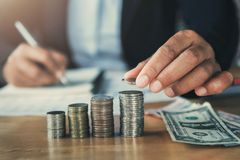 Businessman hand holding money stack for saving. concept finance. And accounting stock photography