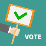 Businessman hand holding paper blank sign plate with green tick check mark. Vote text President election day. Voting concept. Flat design. Vector Royalty Free Stock Photo