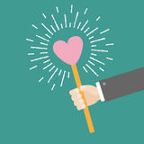 Businessman hand holding paper heart on the stick Shining effect dash line circle Flat design Royalty Free Stock Images