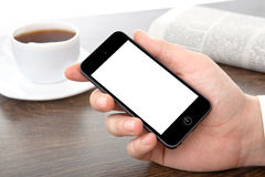 Businessman hand holding a phone with  screen against th Royalty Free Stock Image