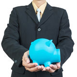 Businessman hand holding piggy bank Stock Images