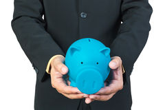 Businessman hand holding piggy bank Stock Image