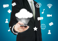 Businessman hand holding smart phone cloud connectivity Stock Photos