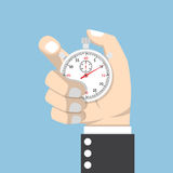 Businessman hand holding stopwatch Royalty Free Stock Image