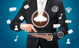 Businessman hand holding tablet cloud connectivity Royalty Free Stock Photos