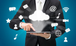 Businessman hand holding tablet cloud connectivity Royalty Free Stock Photography