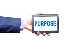 Businessman hand holding tablet with Purpose text sign. Isolated Royalty Free Stock Photos