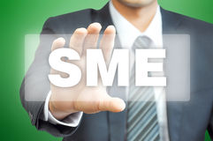 Businessman hand holding virtual screen with SME sign Stock Images