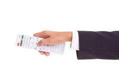 Businessman hand holding white remote Stock Image