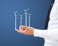 Businessman hand holding wind power Stock Images