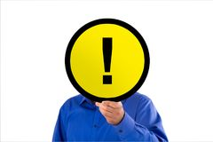 Businessman Hand Holding Yellow Warning Sign with Exclamation Ma royalty free stock photos