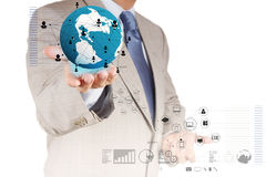Businessman hand holds the earth and social network diagram Stock Image