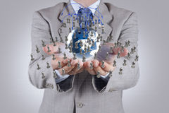 Businessman hand holds social network Stock Image