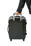 Businessman hand with luggage Stock Image