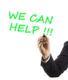 Businessman hand with marker writing text we can help Stock Image