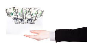 Businessman Hand and money in envelope Stock Photo