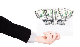 Businessman Hand and money in envelope Stock Photography