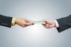 Businessman hand and money to other Royalty Free Stock Photo