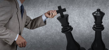 Businessman hand moving chess Royalty Free Stock Photography