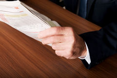 Businessman hand with newspaper Stock Photo