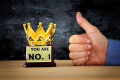 Businessman hand next to award trophy for show victory or winning first place Royalty Free Stock Photography