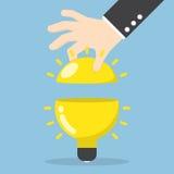 Businessman hand open the light bulb Stock Photography