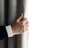 Businessman hand opening curtain, receiving bright light in the morning. with copy space Royalty Free Stock Images