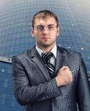 Businessman with hand over heart Royalty Free Stock Photo