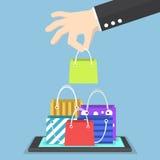 Businessman hand picking shopping bag on tablet Stock Image