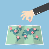 Businessman hand pin target to world map Stock Photo