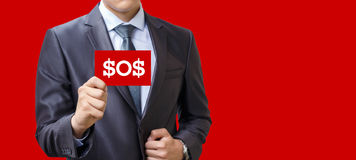 In businessman hand plaque with the inscription sos . In businessman hand plaque with the inscription sos on a red background Royalty Free Stock Images