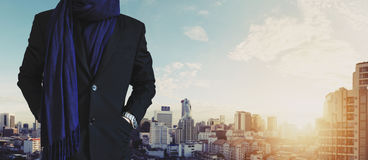 Businessman hand in pocket, in casual suit with Bangkok city view in sunrise Stock Image