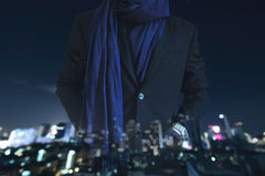 Businessman hand in pocket in casual suit with multiple exposure defocused city at night background Royalty Free Stock Photography