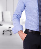Businessman with hand in pocket. Stock Photos