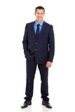Businessman hand in pocket. Portrait of businessman standing with hand in pocket on white background Royalty Free Stock Photos