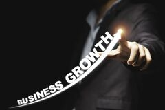 Businessman hand point drawing increase trend arrow and growing of business growth