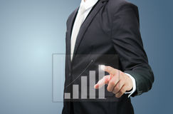 Businessman hand point financial symbols growth. On blue background Stock Photo