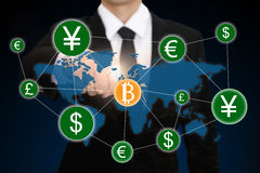 Businessman hand point to bitcoin Stock Image