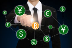 businessman hand point to bitcoin Stock Images